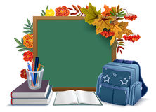Back to school. Blackboard, backpack, books on background autumn leaves Royalty Free Stock Photo