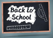 Back to school on blackboard with chalk and rulers Stock Image