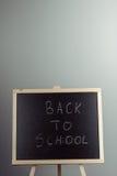 Back to school blackboard, chalkboard. Teacher writing back to school on black chalk board Stock Image