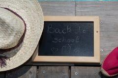 Back to school blackboard / chalkboard. on the wooden deck Stock Photography