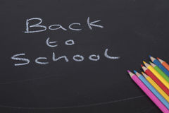 Back to School blackboard concept with pencils. Back to School blackboard concept with colored pencils arranged in the corner and handwritten text with copy Stock Images