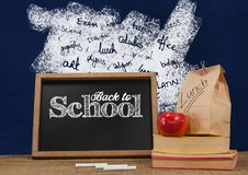 Back to school blackboard on Desk foreground with blackboard graphics of school subjects Stock Photography