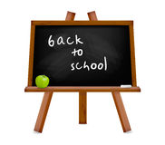 Back to school. Blackboard with easel with text. Stock Image