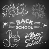 Back to school on blackboard. Hand drawn Back to School Calligraphic Designs Label Set. Imitation drawing with chalk on Chalkboard or blackboard Stock Images