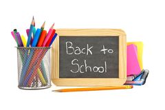 Back to School blackboard with school supplies Stock Images