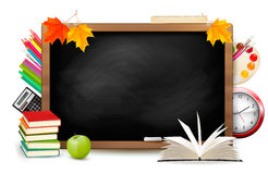 Back to school. Blackboard with school supplies Royalty Free Stock Image