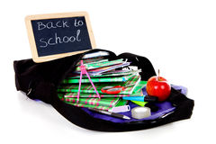 Back to school: blackboard slate on bag with books Royalty Free Stock Photography