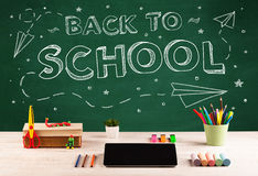 Back to school blackboard and student desk Royalty Free Stock Photos