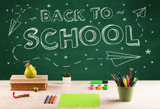 Back to school blackboard and student desk Royalty Free Stock Images