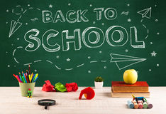 Back to school blackboard and student desk Royalty Free Stock Photo