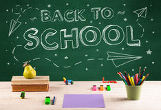 Back to school blackboard and student desk Stock Image