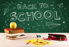 Back to school blackboard and student desk Stock Images