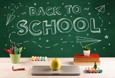 Back to school blackboard and student desk Stock Photo