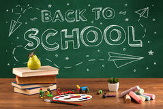 Back to school blackboard and student desk Royalty Free Stock Photography