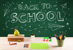 Back to school blackboard and student desk Royalty Free Stock Image
