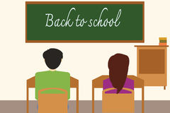 Back to school on the blackboard with students in the classroom. Royalty Free Stock Photo