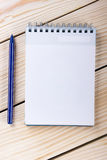 Back to school. Blank note pad, notebook with pen and glasses. On wooden background. Copy Space. Education background Stock Photography