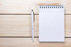 Back to school. Blank note pad, notebook with pen and glasses. On wooden background. Copy Space. Education background Royalty Free Stock Photography