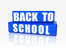 Back to school in blue boxes. Back to school - text over 3d blue rectangles with white letters Stock Image