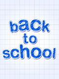 Back to school in blue over squared sheet Royalty Free Stock Photos