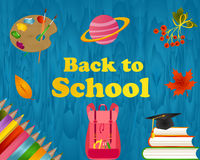 Back to school blue wooden background with pencils, backpack, book, planet, planet, graduate cap and text Royalty Free Stock Photo