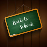 Back to school board hanging on the wood background Royalty Free Stock Images