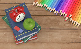 Back to school. Books, alarm clock and colorful pencils on a wooden background, concept of: back to school 3d render Royalty Free Stock Images