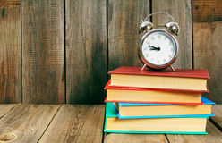 Back to school. Books and an alarm clock. Royalty Free Stock Photography