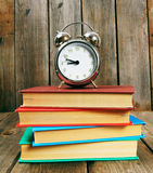 Back to school. Books and an alarm clock. Royalty Free Stock Images