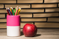 Back to school,. School books with apple on desk Royalty Free Stock Photos