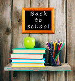 Back to school. Books, an apple and pencils . Royalty Free Stock Photo