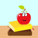 Back to school: books and red smiling apple Stock Image