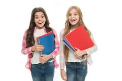 Back to school books to share. Little school children holding note books. Adorable small girls with school exercise stock photo