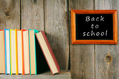Back to school. Books on wooden shelf and frame. Stock Images