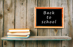 Back to school. Books on wooden shelf and frame. Royalty Free Stock Photography