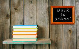 Back to school. Books on wooden shelf and frame. Stock Image