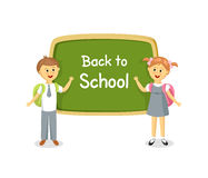 Back to school. Boy and girl standing near school board Stock Photography