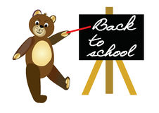 Back to school. Brown teddy bear with red pointer by blackboard. Welcome banner for beginning of the school year. Royalty Free Stock Photos