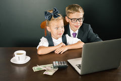 Back to school. Business kids smiling, uses laptop Royalty Free Stock Photo