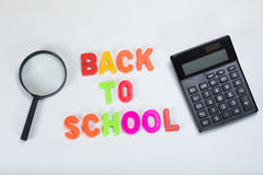Back to school calculator and magnifying glass Royalty Free Stock Photos