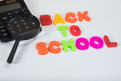 Back to school calculator and magnifying glass Royalty Free Stock Photo