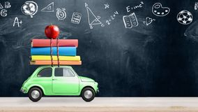 Back to school car animation. Back to school looped 4k animation. Car delivering books and apple against school blackboard with education symbols stock photo