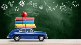 Back to school car animation. Back to school looped 4k animation. Car delivering books and apple against school blackboard with education symbols stock photography