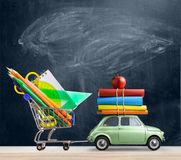 Back to school car. Back to school sale background. Car delivering shopping cart with accessories, books and apple against blackboard stock images