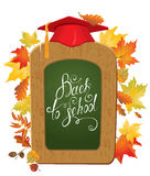 Back To School card.  Green chalkboard, Graduation Cap and autum Stock Images