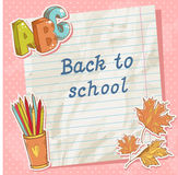 Back to school card on paper sheet with study item Royalty Free Stock Image