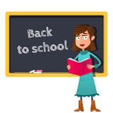 Back to school. Cartoon Female teacher with book in hand stands at the blackboard Stock Photos