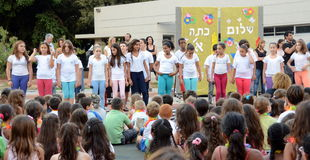 Back to school ceremony. Children aged 11-12 performing in a back-to-school welcome ceremony for first graders on August 25, 2013 in Kfar Saba, Israel Royalty Free Stock Photo
