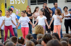 Back to school ceremony. Children aged 11-12 performing in a back-to-school welcome ceremony for first graders on August 25, 2013 in Kfar Saba, Israel Royalty Free Stock Photography