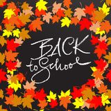 Back to school. Chalk lettering on blackboard surface. Typography poster with autumn leaves. Vector illustration. Back to school. Chalk lettering on blackboard Stock Photo